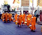 Buddhist monks on a street in Bangkok
